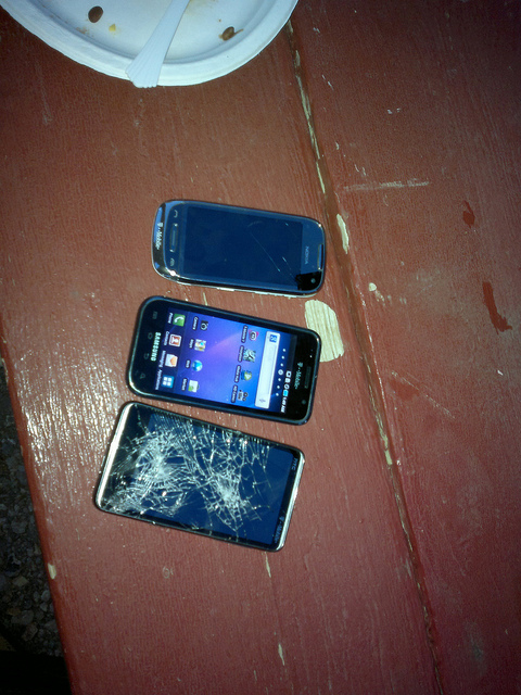 3 phones, small crack on screen
